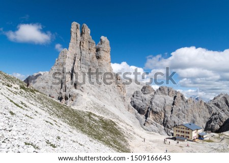 Trekking among the mountain refuges of the Italian Dolomites, panoramas and landscapes of high altitude Alps