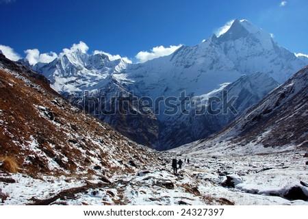 Trekking at the Foot of Machapuchare (Annapurna, Nepal) #24327397