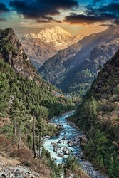 Trekking in the Himalayas : Stunning mountain views on the Mount Everest trekking route, Nepal. Ama Dablam summit and peak in the frame