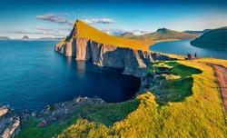 Trekking to Sorvagsvatn lake, Vagar, Faroe Islands, Denmark, Europe. Unbelievable summer seascape of Atlantic Ocean. Aerial landscape photography. Beauty of nature concept background.