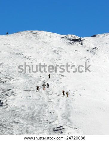 Trekking uphill in the the snowy mountains. Mala Fatra range, Carpathians,  Slovakia.
