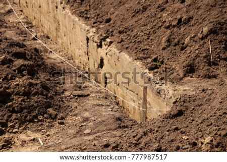 Trench prepared for a cottage concrete deep strip foundation Stock photo ©