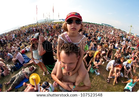 TRENCIN,SLOVAKIA - JULY 7:Little girl at the Pohoda Music Festival at the Trencin Airport in Trencin, Slovakia on July 7, 2012.