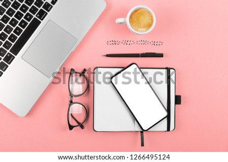 Trend photography on the theme of the new color of the year 2019 - Living Coral. office desk table with a lot of things on it. Top view with copy space. #1266495124