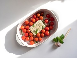 Trending viral Feta bake pasta recipe made of tomatoes, cheese, garlic and herbs in a casserole dish.