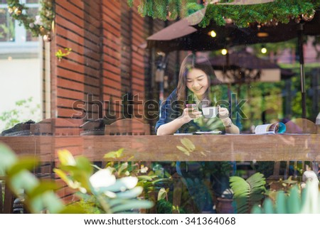 Trendy and beautiful young woman typing on a smartphone, Asian woman with phone. #341364068