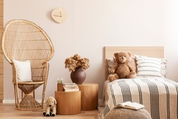 Trendy bedroom interior with wooden furniture and toys in scandinavian style