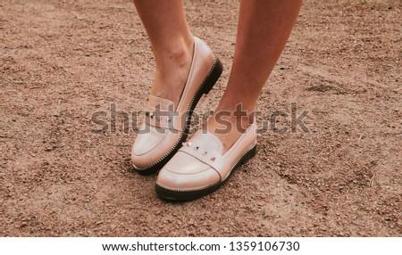 Trendy beige feminine loafers. Women's shoes