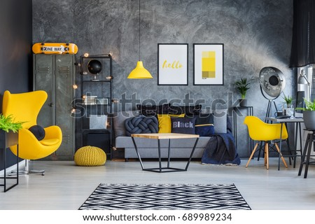 Trendy canary yellow accessories in contemporary room for teenage boy #689989234