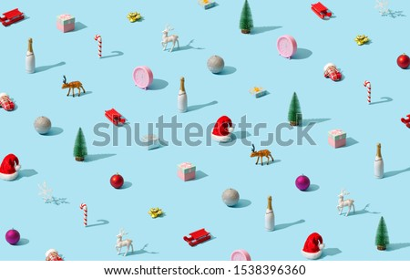 Trendy Christmas pattern made with various winter and New Year objects on bright light blue background. Minimal Christmas concept.