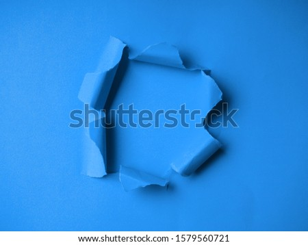 trendy color 2020 blue classic Hole in the paper with torn side. torn paper on blue #1579560721