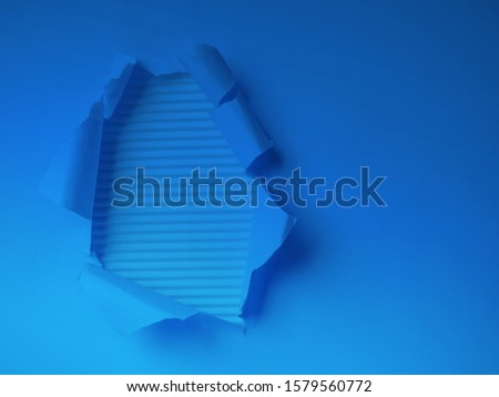 trendy color 2020 blue classic Hole in the paper with torn side. torn paper on blue color. #1579560772