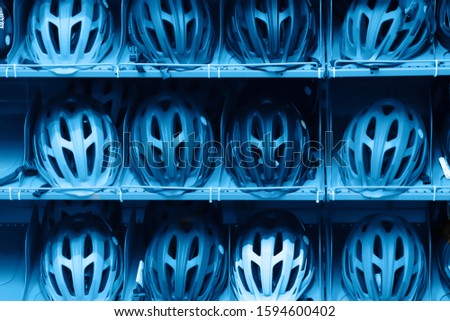 Trendy color of the year 2020. Bike helmets. Bicycle helmets in a bike shop showcase. Front view
