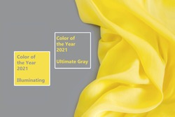 Trendy Color of the Year 2021. Illuminating Yellow and Ultimate Gray. Beautiful abstract silk fabric background. Copy space, flat lay.