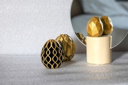 Trendy Easter low poly decor. Golden and black eggs of geometric style. Happy Easter greeting card. Holiday concept in minimal style