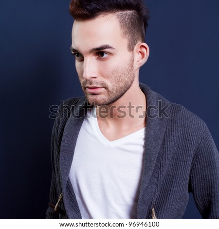trendy european man dressed in contemporary cloth, he is now a professional model