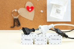 Trendy flat lay minimal concept, unplugged cord with word work, media, wi-fi