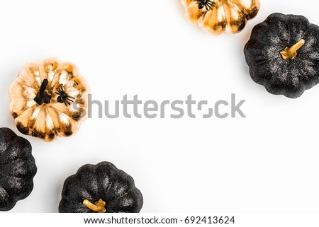 Trendy Frame background with black and gold Halloween pumpkin with copy space for text. isolated on white background. Flat lay, top view.