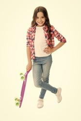 Trendy girl. Summer vacation. Kid having fun with penny board. Child smiling face stand skateboard. Penny board cute skateboard for girls. Lets ride. Girl ride penny board white background