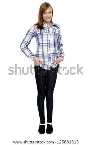 Trendy girl with long hair posing smartly. Full length shot against white background.