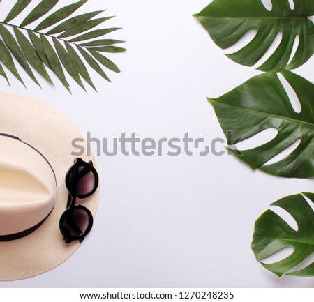 trendy hat, sunglasses and palm leaves on a white background #1270248235