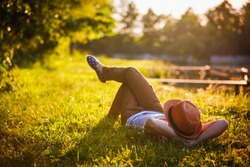 Trendy Hipster Girl Relaxing on the Grass