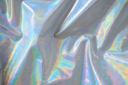 trendy holographic background.Silver metallic iridescent background.pastel colored  holographic texture in pink violet, Silver and  green colors.colorful chrome fabric.