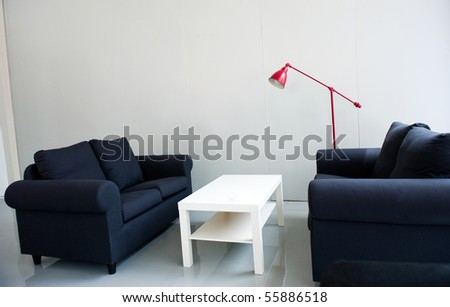 Trendy living room - modern sofa, chairs , tables and red standard lamp.