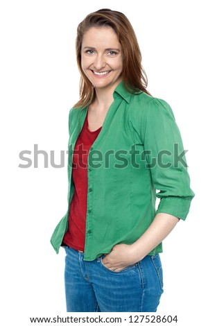 Trendy middle aged caucasian posing with hands in jeans pocket.