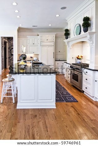 trendy modern kitchen remodel in white and black - stock photo