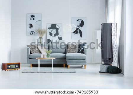 Trendy monochromatic studio with vintage radio and black and white posters on wall #749185933