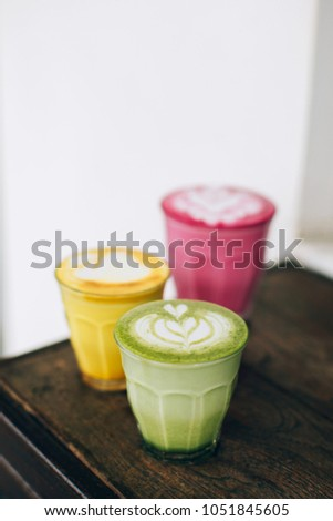 Trendy multicolored lattes. Beetroot, avocado and turmeric tastes with latte art. #1051845605
