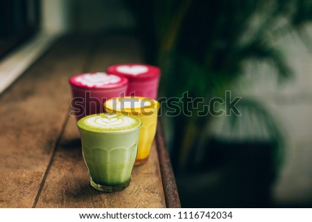 Trendy multicolored lattes. Beetroot, avocado and turmeric tastes with latte art. #1116742034