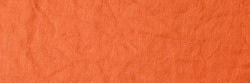 Trendy red orange color pure linen texture. Natural flax fabric background.  Eco friendly raw sack cloth pattern. Burlap organic canvas banner