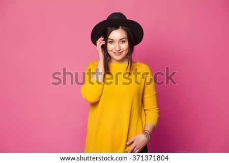 Shutterstock Trendy sexy young female wearing casual clothes posing over pink background
