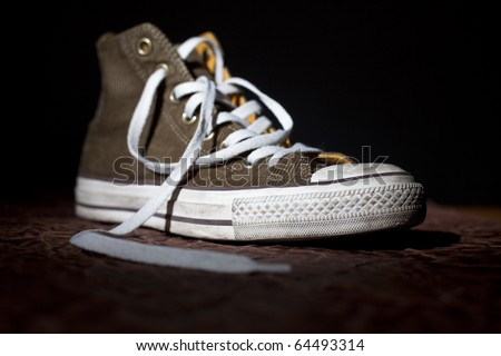 trendy sport shoe highlighted on black background