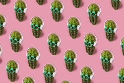 Trendy sunlight Summer pattern made with cactus pattern with headphones on pastel pink background. Minimal summer vacation concept.