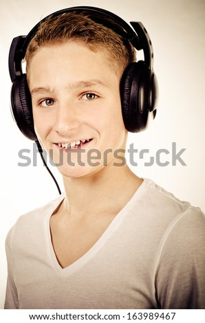 trendy teenage boy with headphones
