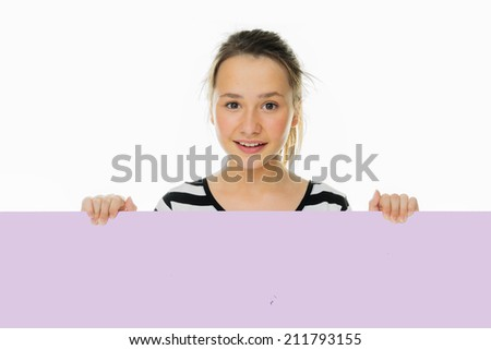 Trendy teenage girl holding to a blank card on white background