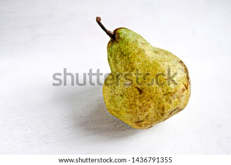 Trendy ugly organic fruits -one yellow pears on the table with copy space for text.  Buying imperfect products is a way to deal with food waste. Horizontal. #1436791355