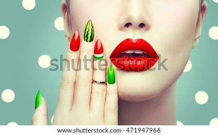 Trendy Watermelon Summer Manicure and Red Lips. Beauty Fashion Makeup and Manicure. Glamour Nail Art and Make up closeup over polka dots background