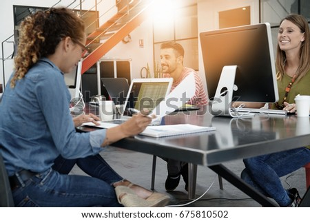 Trendy young people working in co-working office  #675810502