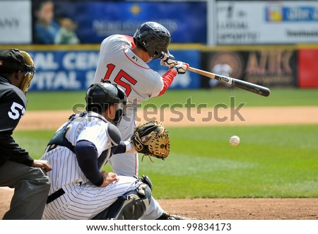 TRENTON, NJ - APRIL 11: Portland Sea Dogs infielder Derrik Gibson hits a grounder during the Eastern League game against Trenton April 11, 2012 in Trenton, NJ.
