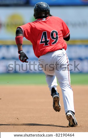 TRENTON, NJ - JULY 31: Richmond Flying Squirrels' Fancisco Peguero heads for second base after hitting what would be a triple during a game against the Trenton Thunder on July 31, 2011 in Trenton, NJ.