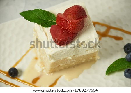 Tres Leche Cake. This dessert is made with egg whites, three types of milk and flavored with Madagascar vanilla bean.  The topping is a mascarpone whipped cream.  A delicious after dinner delight. Zdjęcia stock ©