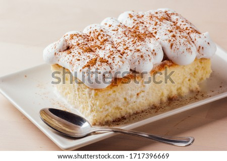 Tres leches cake, typical Latin American dessert, is made of condensed milk, evaporated milk and milk cream