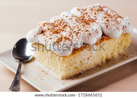 Tres leches cake, typical Latin American dessert, is made of condensed milk, evaporated milk and milk cream Zdjęcia stock ©