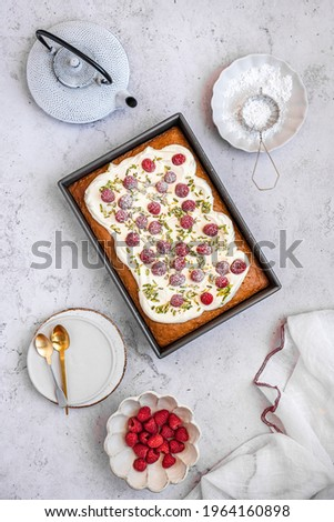 Tres Leches Cake with Fresh Raspberries and Slivered Pistachio Zdjęcia stock ©