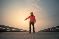 treveler man with red sweatshirt on the bridge and touch sunset