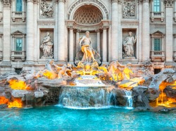 Trevi fountain at sunrise, Rome, Italy. Rome baroque architecture and landmark. Rome Trevi fountain is one of the main attractions of Rome and Italy